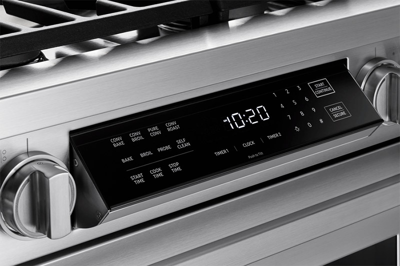 The touch glass panel command center of a Dacor professional style 36 inch dual-fuel range.