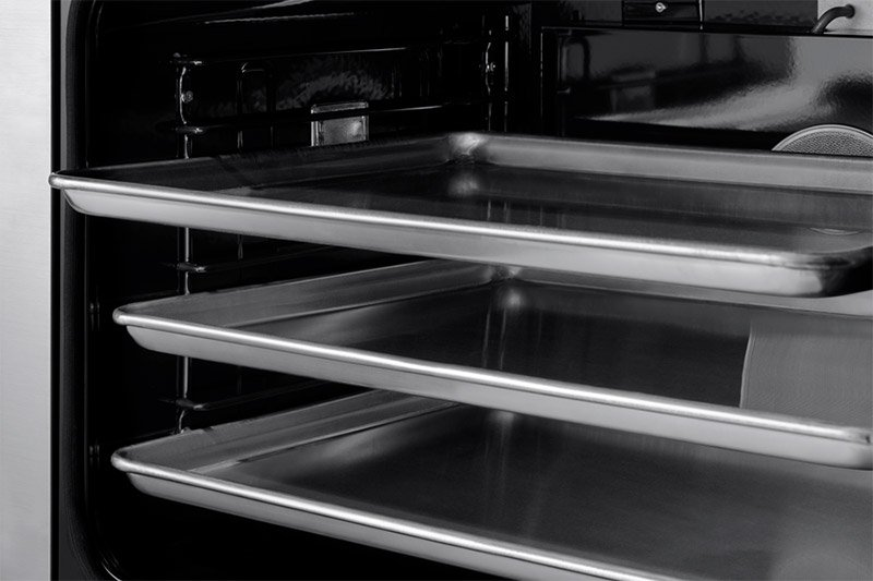 The oven pans inside the oven of a Dacor professional style 36 inch dual-fuel range.