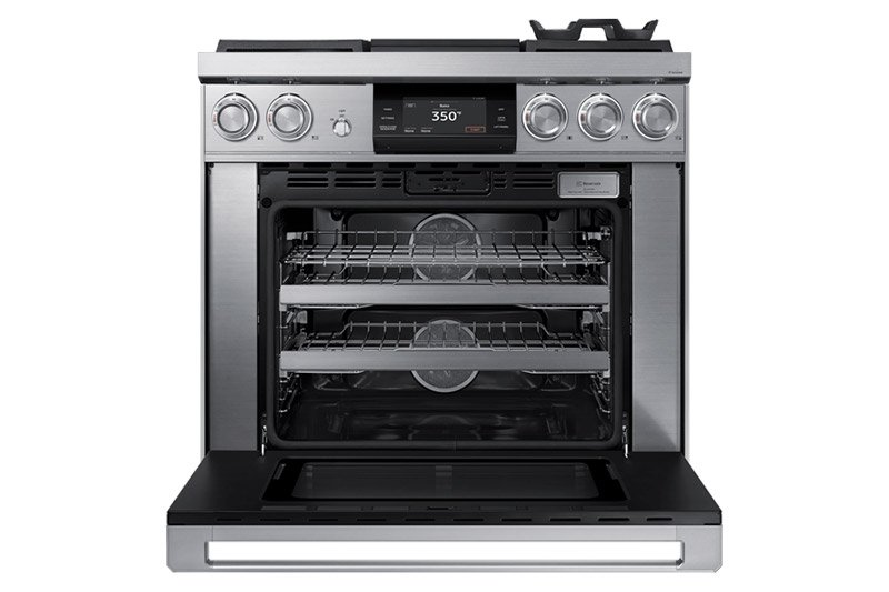 A silver stainless steel Dacor contemporary style 36 inch gas range with the oven door open.