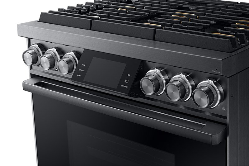 The knobs and controls of a Dacor contemporary style 36 inch gas range.