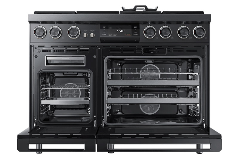 A graphite Dacor oven range with the oven doors open.
