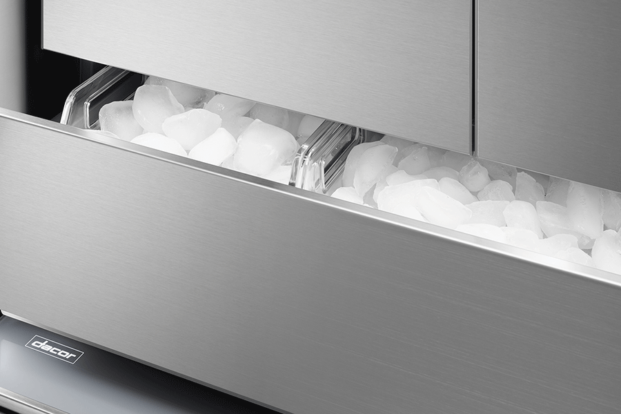 A Dacor column refrigerator, with the bottom drawer open revealing an ice compartment.