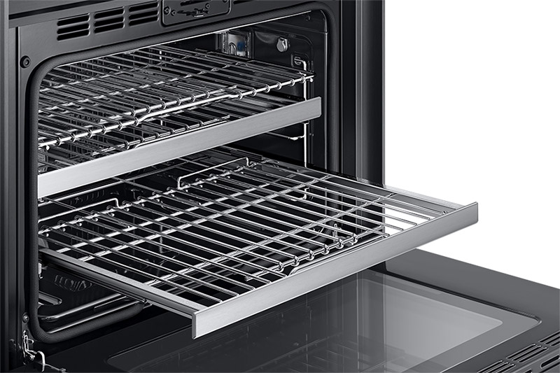 A Dacor contemporary style 36 inch gas range, with the oven door fully open and an oven rack pulled out.