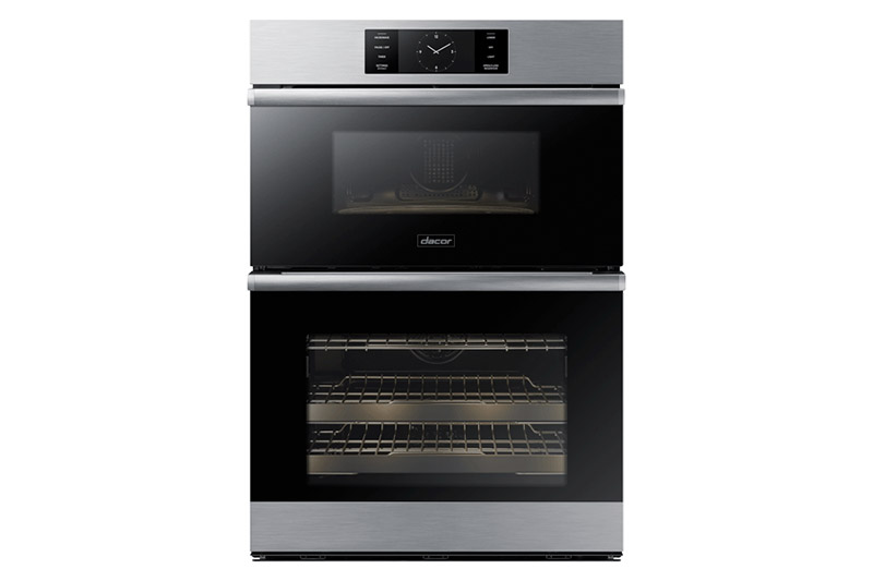 A Dacor contemporary style 30 inch combination wall oven, with the oven and microwave lights on.