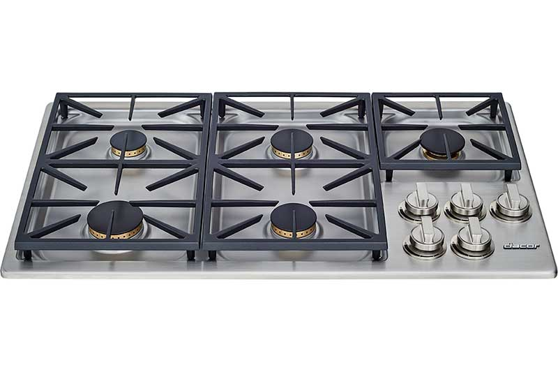 A silver stainless steel Dacor professional style 36 inch gas cooktop.