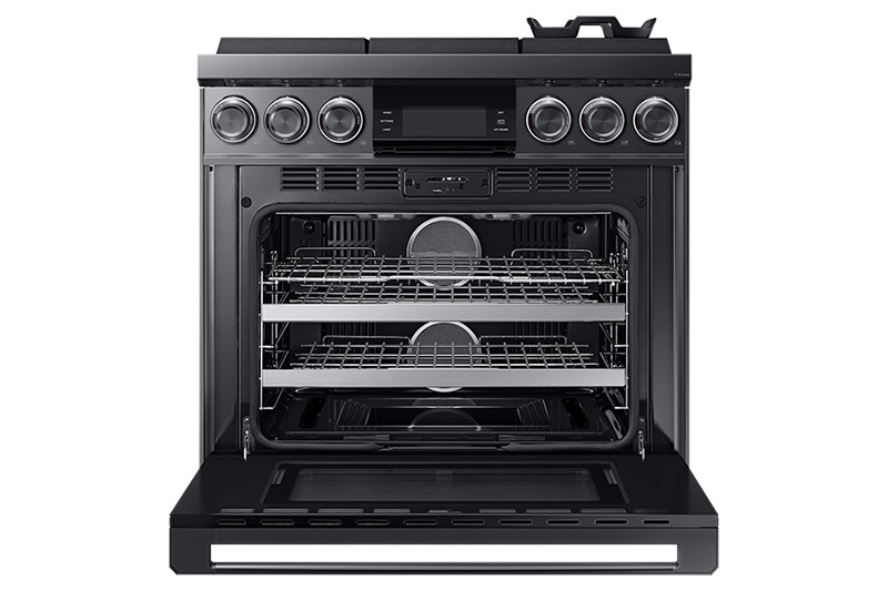 A graphite Dacor contemporary style 36 inch gas range with the oven door open.