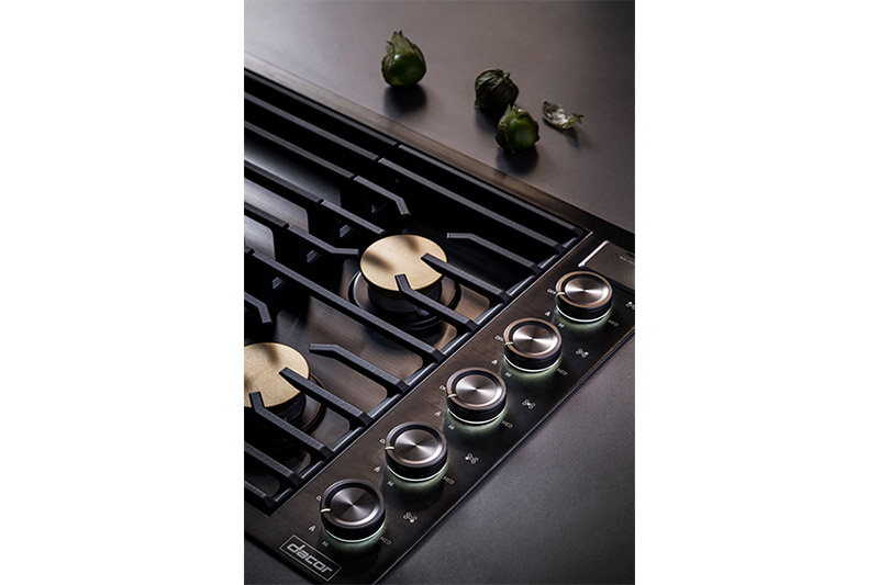 The control knobs of a graphite Dacor contemporary style 36 inch gas cooktop.