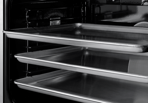 The oven pans inside the oven of a Dacor professional style 30 inch gas range.