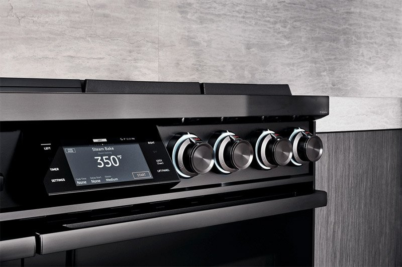 LCD touch screen and knobs on a graphite Dacor range.