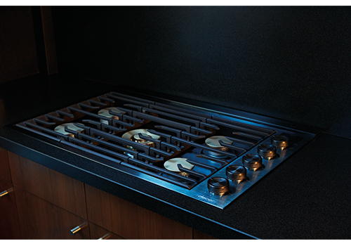 A Dacor contemporary style 36 inch gas cooktop.
