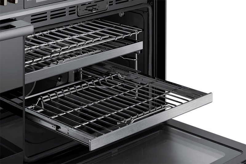 A Dacor contemporary style 48 inch gas range, with the oven door fully open and an oven rack pulled out.