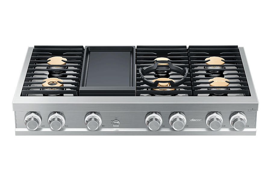 A silver stainless steel Dacor rangetop with griddle.