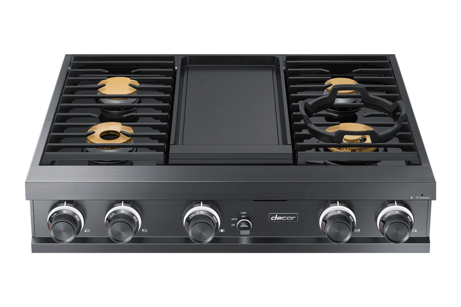 A graphite Dacor rangetop with griddle.