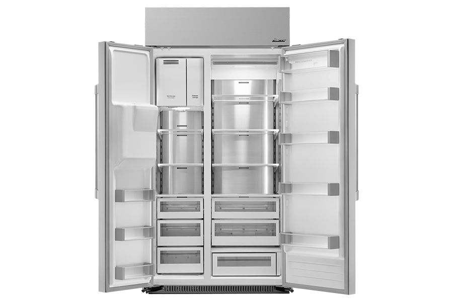 A Dacor side-by-side refrigerator with both refrigerator doors fully open.