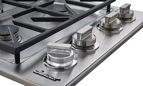 The knobs of a silver stainless steel Dacor professional style 30 inch gas cooktop.