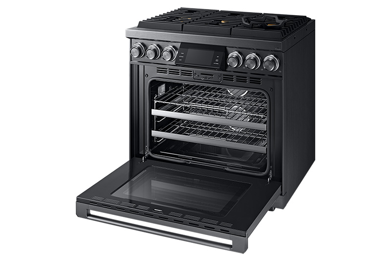 A graphite Dacor contemporary style 36 inch gas range with the oven door fully open.