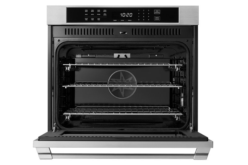 A Dacor professional style 30 inch single wall oven with the oven doors open.
